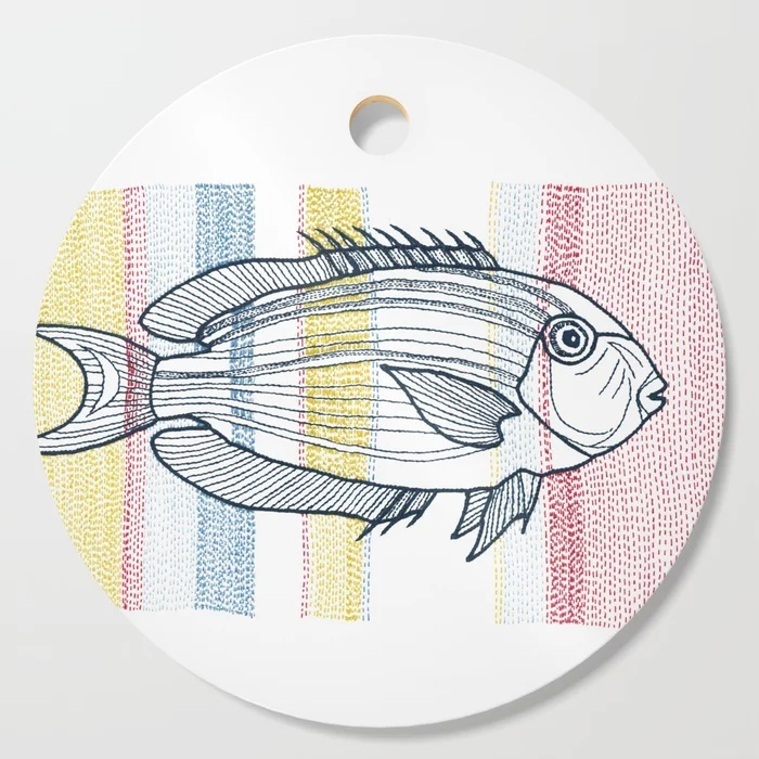 stitches - fish, a VrijFormaat design on a Society6 cutting board
